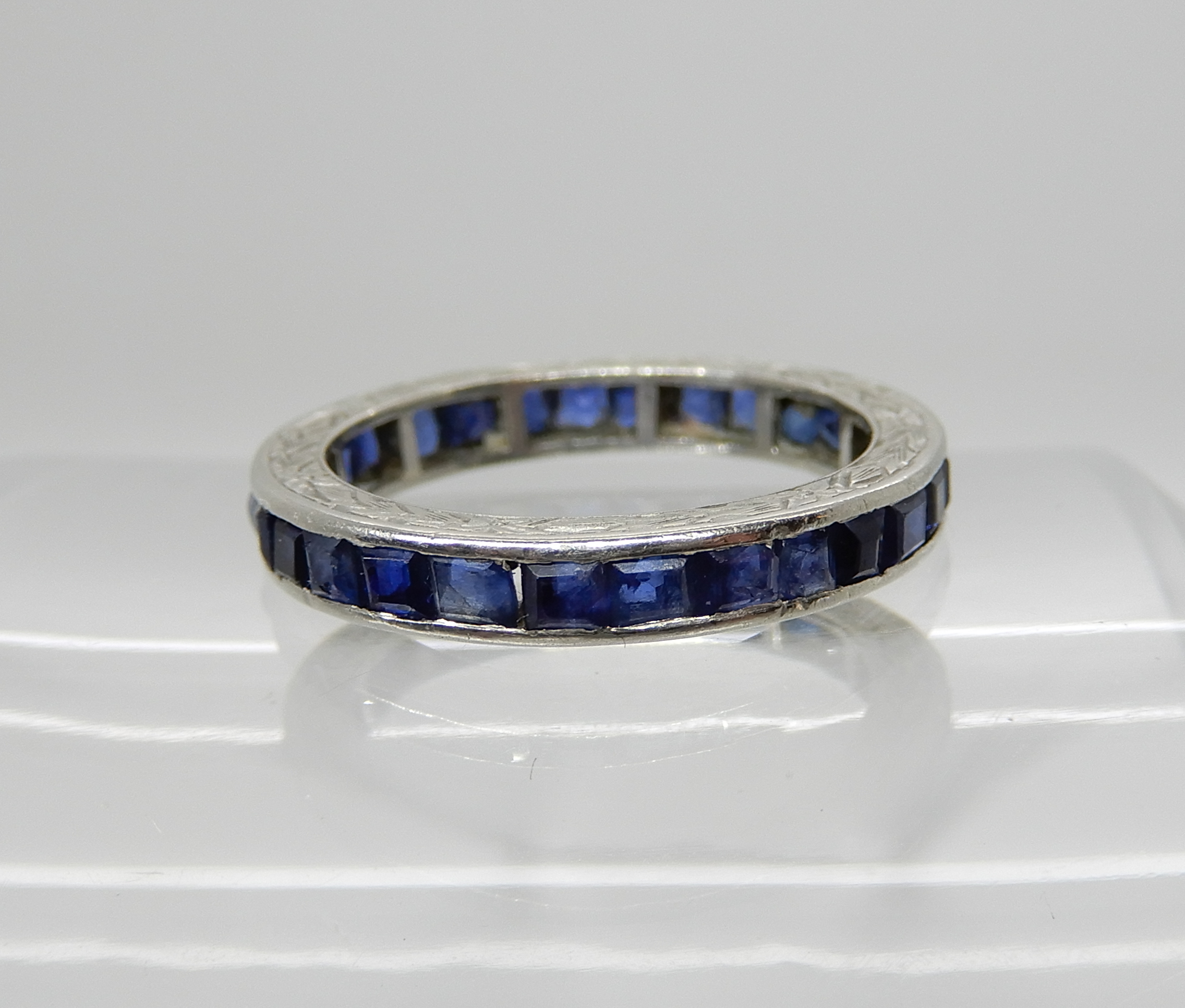 Lot 8 - A white metal sapphire set full eternity ring, size L, weight 3.3gms Condition Report: Some damage
