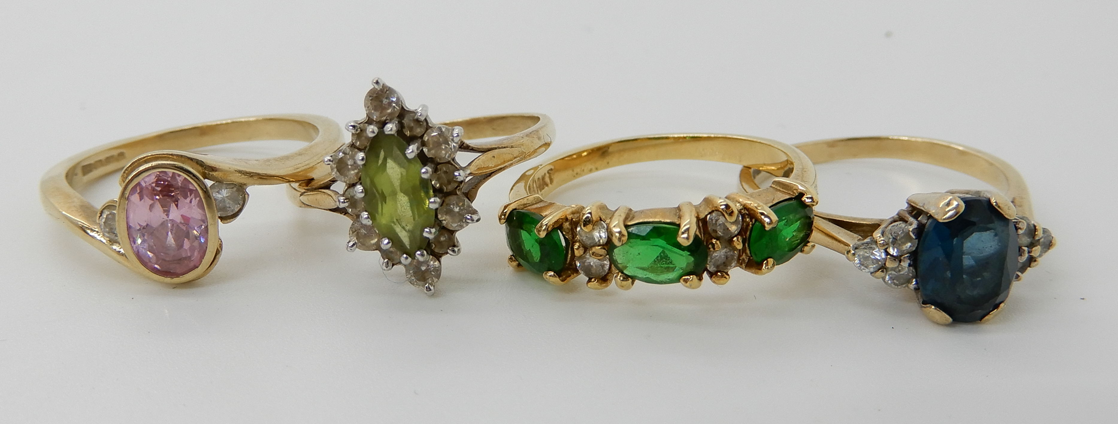 Lot 3 - A 9ct peridot and clear gem set ring size P1/2, 9ct pink and clear gem set ring size P1/2 and