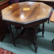 An octagonal rosewood inlaid window table Condition Report: