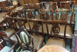 A set of twelve Chippendale style dining chairs with leather seats (four carvers and eight