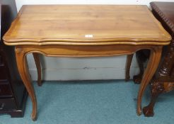 A reproduction fold over card table Condition Report: Available upon request