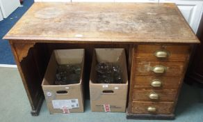 A pine desk with five drawers Condition Report: 78cm high x 122cm wide x 62cm deep.