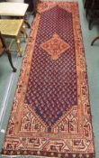 A blue ground Araak runner with central medallion, 307cm x 90cm Condition Report: Available upon
