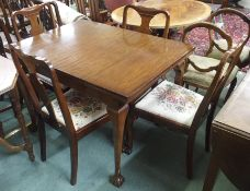 A mahogany sideboard, 95cm high x 143cm wide dining table and four chairs (6) Condition Report: