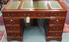 A reproduction mahogany pedestal desk with green leather skivers, 76cm high x 120cm wide Condition