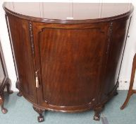 A mahogany bow front cabinet with single door, 99cm high x 108cm wide Condition Report: Available