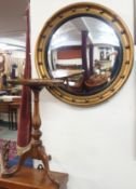 A circular gilt mirror and a walnut wine table (2) Condition Report: Available upon request