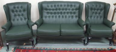 A green vinyl high back Chesterfield sofa with matching armchairs (3) Condition Report: Available