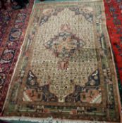 An Eastern rug with central medallion, 240cm x 147cm Condition Report: Available upon request