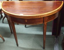 An inlaid mahogany fold over tea table Condition Report: Available upon request
