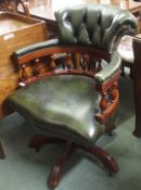A green leather captains chair Condition Report: Available upon request