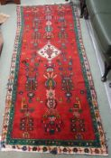 A red ground Eastern runner, 248cm x 92cm Condition Report: Available upon request