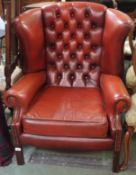 A red leather Chesterfield wing back chair Condition Report: Available upon request