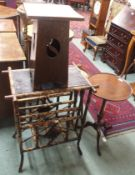 A Victorian bamboo table with lower magazine rack, an oak Arts and crafts side table and a