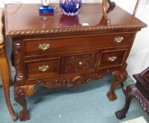 A reproduction carved mahogany low boy, 79cm high x 90cm wide Condition Report: Available upon