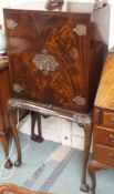 A walnut drinks cabinet, 132cm high x 70cm high Condition Report: Available upon request