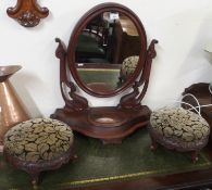 A pair of Victorian walnut carved footstools and a mahogany toilet mirror (3) Condition Report: