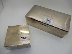 A lot comprising two silver cigarette boxes, 20.2cm x 10.5cm and 8.5cm square Condition Report: