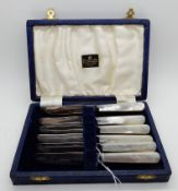 A cased set of six mother of pearl and silver bladed butter knives, Sheffield 1948 Condition Report: