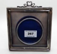 A silver mounted photo frame, Birmingham 1907, 13.5cm square, aperture 8cm diameter Condition