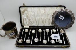 A lot comprising a cased set of twelve coffee spoon, a silver christening mug and a white metal
