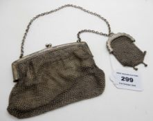 A lot comprising a silver and metal mesh purse, London 1916 and a small metal mesh purse Condition