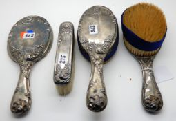 A five piece silver backed dressing table set, Birmingham 1887 Condition Report: Available upon