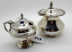 A lot comprising two silver mustard pots, London 1903 and Chester 1930 (2), 228gms Condition Report: