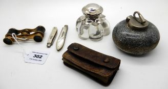 A lot comprising an inkwell modelled as a curling stone, another inkwell and a pair of opera glasses