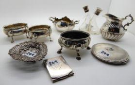 A lot comprising a pair of silver salts, a single salt, a cream jug, an 800 silver sugar bowl, a bon