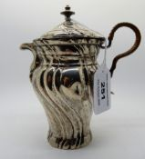 A continental white metal pot and cover, the balluster body with spiral fluting, 15cm high Condition