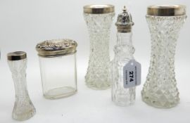 A lot comprising a pair of silver mounted glass vases, a silver topped jar, EP topped cruet bottle