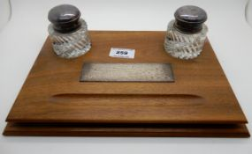 An oak and EP double inkstand with silver plaque, Birmingham 1965, 29cm x 20cm Condition Report: