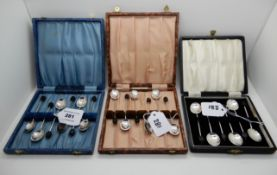 A lot comprising three cased sets of silver coffee bean spoons, Birmingham 1923, 1924 and 1938