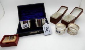 A lot comprising two pairs of cased silver napkin rings, London and Birmingham marks and a silver