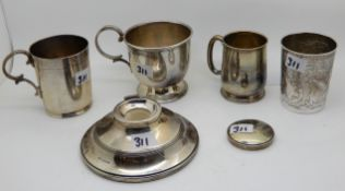 A lot comprising two silver mugs, London 1933, Birmingham 1925, a silver beaker, an inkwell (def)