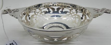 A silver quaich style bowl with pierced decoration, 26.5cm across the lugs, Sheffield 1912, 323gms