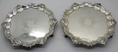A pair of silver card trays, London 1751, of circular form with scalloped edge and shell motif on