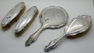A four piece silver backed dressing table set, Birmingham 1944 Condition Report: Available upon