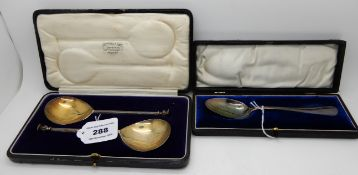A lot comprising a cased pair of silver seal-top serving spoons, Sheffield 1925 and a cased