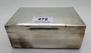 A silver cigarette box, London 1928, 14cm x 9cm Condition Report: Available upon request