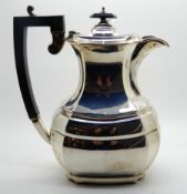 A silver hot water pot, Sheffield 1932, 23cm high, 679gms Condition Report: Available upon request
