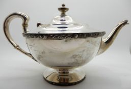 A silver teapot, Glasgow 1925, of tapering circular form with a band of Celtic decoration, bears