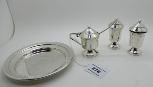 A three piece silver condiment set on stand, Birmingham 1921, 192gms Condition Report: Available