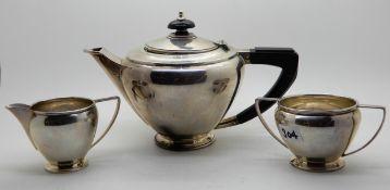 A bachelor's three piece silver tea service, Birmingham 1934, each piece monogrammed 'R', 631gms