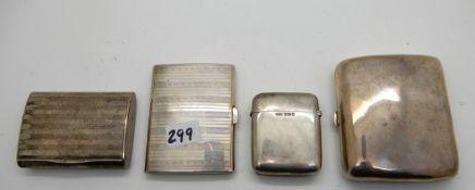 A lot comprising two silver cigarette cases, a silver vesta and an 800 silver card case, 383gms