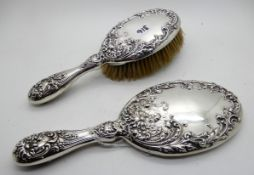 A silver backed brush and mirror set, Chester 1902 Condition Report: Available upon request