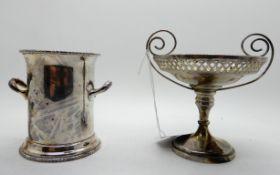 A lot comprising a silver pedestal bon bon dish, 8.5cm high and a silver bottle stand, 8.7cm high,