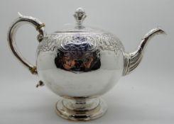 A silver teapot, Edinburgh 1804, of globular form with engraved decoration, 17cm high, 600gms
