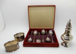 A lot comprising a cased set of six silver coffee spoons, Sheffield 1946, a pepper pot and a pair of